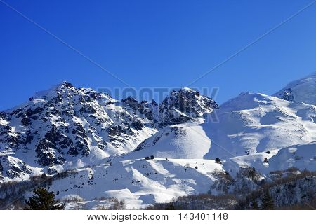 Snowy Mountains And Off-piste Slope On Sunny Day