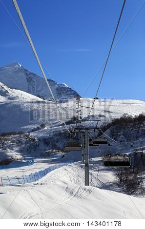 Chair-lift At Ski Resort In Sun Winter Morning