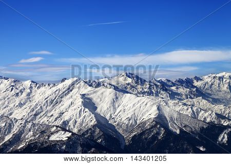 Snowy Mountains And Blue Sky With Clouds In Nice Sunny Day