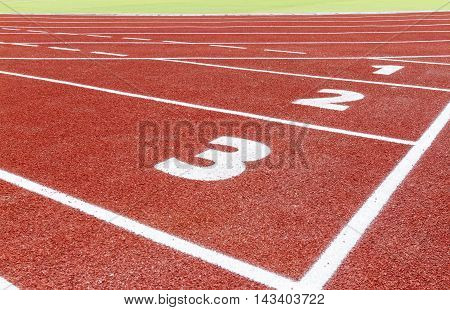 The beginning of the athletics track with three numbers