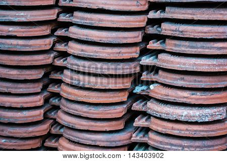 Stacked old roof tiles in the yard