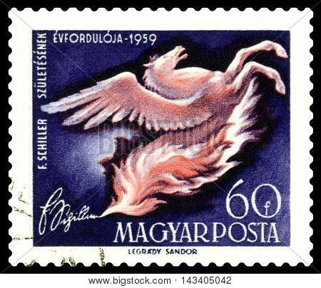 STAVROPOL RUSSIA - August 17 2016: a stamp printed in Hungary shows a picture of artist Legdary Sandor Pegasus rearing from flames dedicated to F. Schiller circa 1959