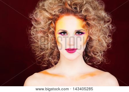 Glamorous Woman. Fashion Makeup and Blonde Curly Hair