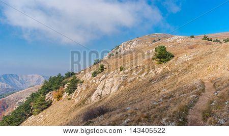 Panoramic landscape with hiking path on a mountain pasture Demerdzhi Crimean peninsula