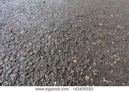Background of wet gray asphalt bitumen for texture