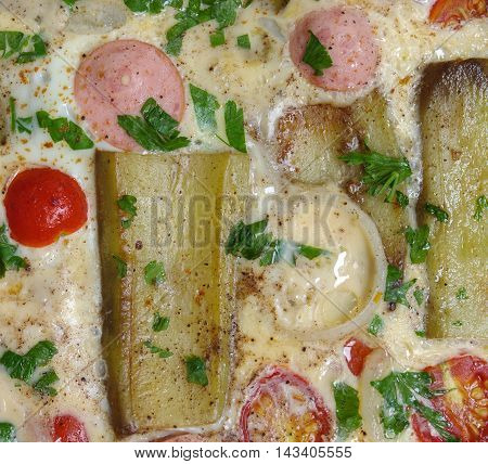 Summer food background - omelette with with cherry tomatoes aubergine and sausage