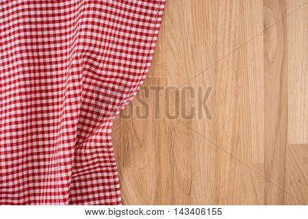 the checkered tablecloth on wooden table. Empty template.