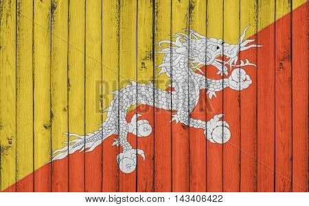 Flag of Bhutan painted on wooden frame