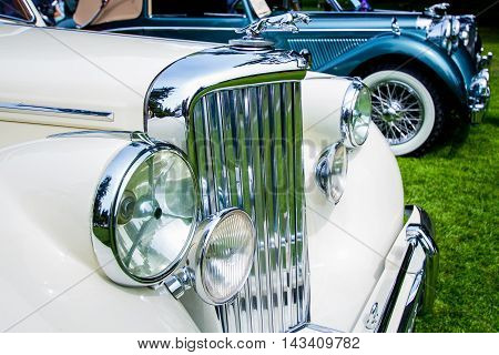 chrome grill and hood ornament on classic cars