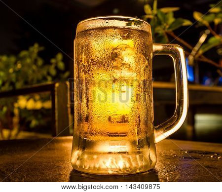 Gold beer with froth on top. Draft cold beer in glass jars in pub hotel or restaurant
