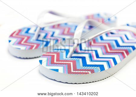 Colored flip flop sandals on white background