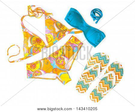 Yellow swimwear and flip-flops on the white background