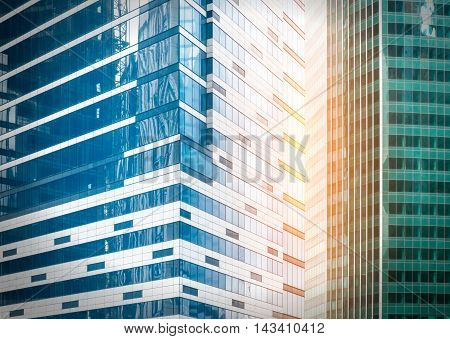 Fragment view of modern business glass buildings with sunflare effect