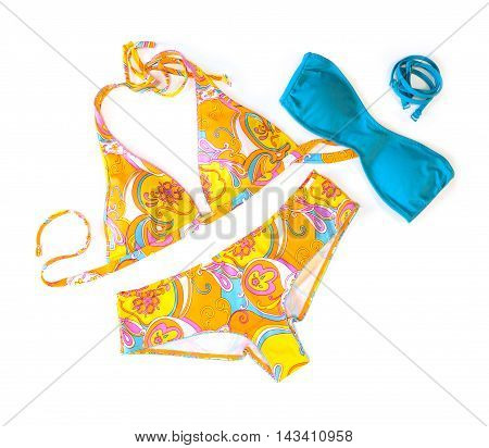 Swimsuite and bra on the white background
