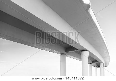 Underside of an elevated road in black and white