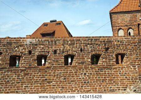 ancient wall fragment of crusaders castle in Torun Poland