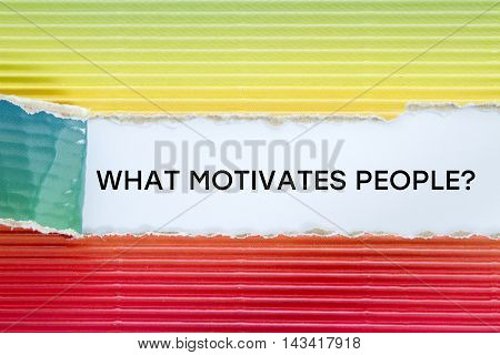 WHAT MOTIVATES PEOPLE? question written under torn paper.