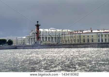 View on Vasilevsky Island Rostral columns and building of the Stock Exchange by the Neva River