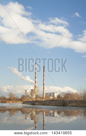 Cogeneration heat and power CHP plant in Krakow Poland sunlit clouds on blue sky autumn