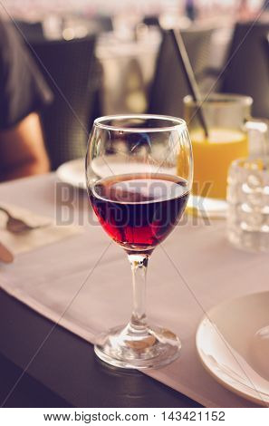 Half glass of red wine in restaurant