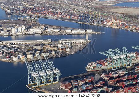 Los Angeles, California, USA - August 17, 2016:  Afternoon aerial view of Los Angeles harbor berths, cranes and containers.