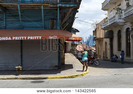 Panama City Panama - March 16 2014: People in a street in Casco Viejo in Panama City Panama. Casco Viejo is the historic district of Panama City