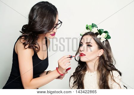 two Beautiful Woman Make-up Artist. Stage Makeup