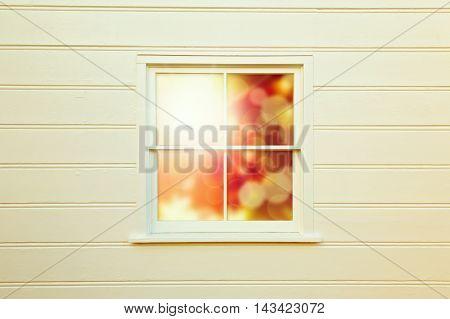 Autumn light wooden background with window over sunny day