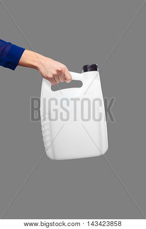 Engine Oil In Canister In Hand Isolated On Grey Background