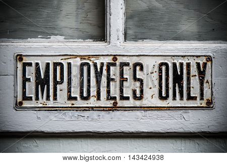 An Employees Only Sign On A Rustic Wooden Door