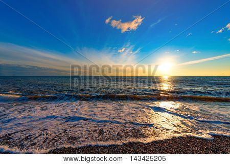 Sunset sky over the calm surface of the sea.