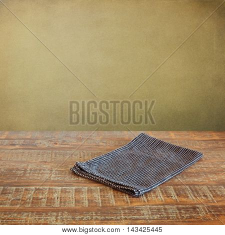 Dark tablecloth on retro empty wooden table