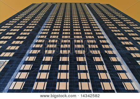 City office towerblock under a golden sky