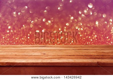 Bokeh background with empty wooden deck table. Christmas background