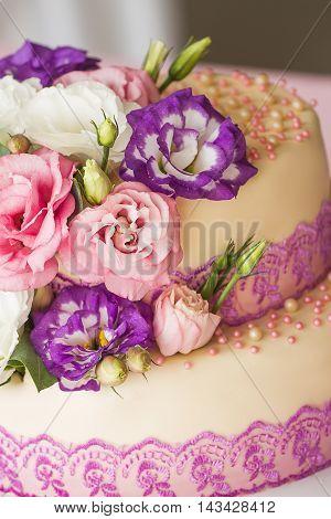 Cake is ivory color with flowers.Elegant wedding cake