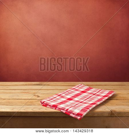 Empty wooden table with tablecloth for product montage display