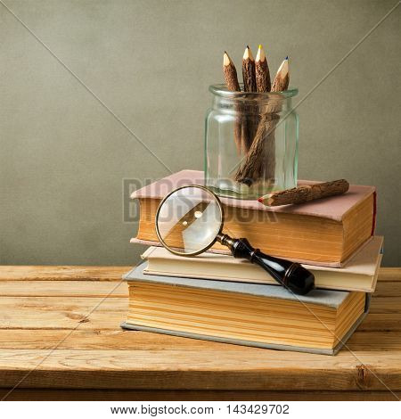 Vintage still life with books on wooden table