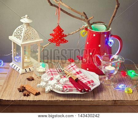 Christmas celebration table with plate and Christmas decorations