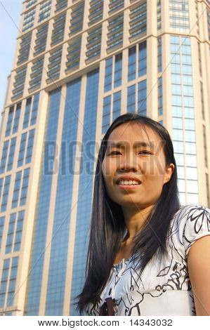 Young Thai woman in Bangkok with tower-lock behind