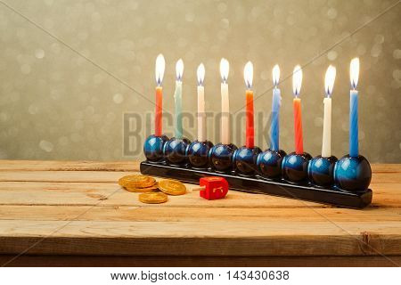 Jewish Holiday Hanukkah background with menorah and lights