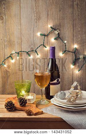 Christmas table setting with candles and Christmas lights
