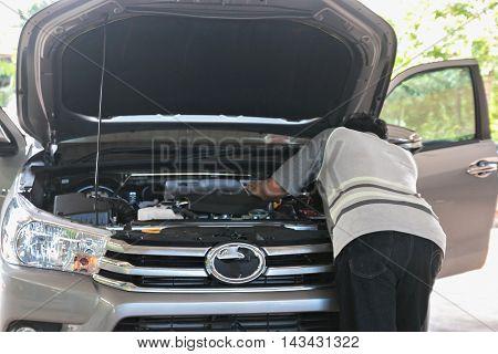 auto mechanic repairing a car engine .