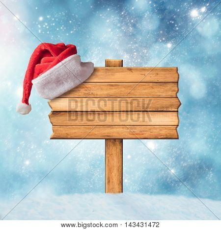 Wooden sign and Santa Claus Hat over winter background