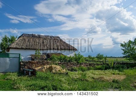 Traditional Ukrainian beautiful house with a thatched roof