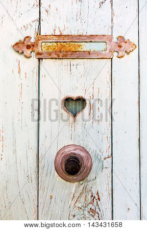old door with rusted mail slot and heart