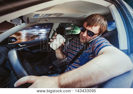 Man speaking on the phone in the car