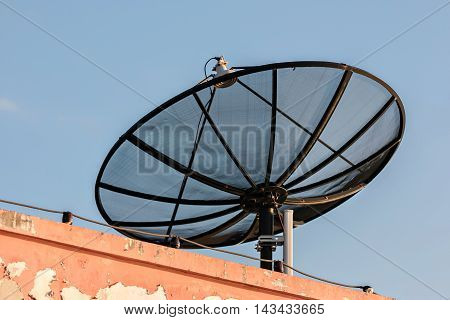 Satellite dish on the roof to receive TV signals.