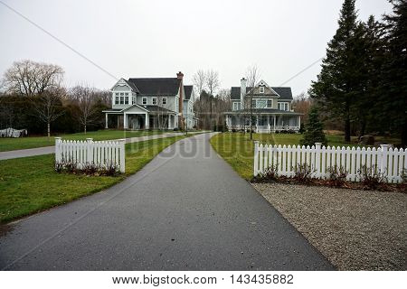 WEQUETONSING, MICHIGAN / UNITED STATES - DECEMBER 22, 2015: Long driveways lead to two large homes on Pennsylvania Avenue in Wequetonsing, Michigan.