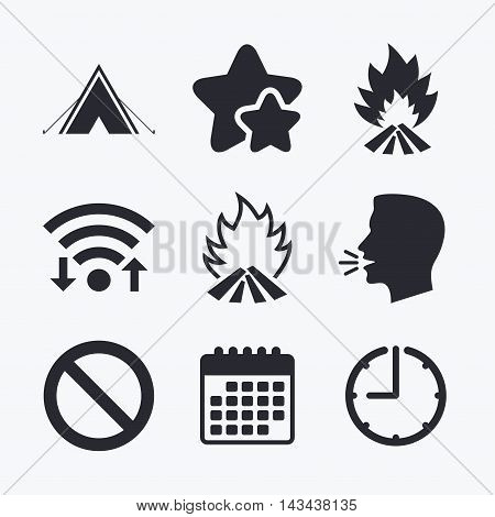 Tourist camping tent icon. Fire flame and stop prohibition sign symbols. Wifi internet, favorite stars, calendar and clock. Talking head. Vector