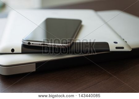 close up phone on tablet and laptop new technology concept